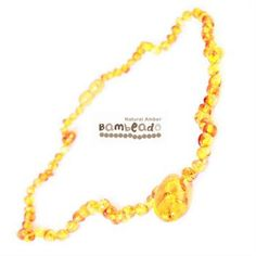 This premium amber necklace comes in honey and features a large amber piece as the pendant at the front. Amber beads are finished in a polish compared to the standard bud range. The amber necklace is approx 50 cm in length. Bambeado amber is genuine baltic amber.     The Bambeado comes together with a plastic screw clasp. While Bambeado amber comes in several colours, the colour is just a matter of personal choice.