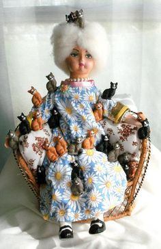 Crazy Cat Lady..... I feel like this will be me someday...... Super creepy doll btw