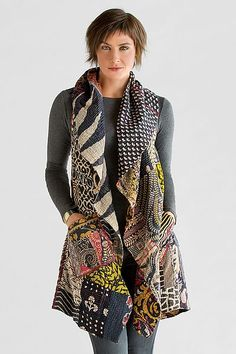 "Mieko Mintz ""Kantha Patchwork Vest"" Black, Side 1 View, Cotton Vest  This fully reversible vest is a perfect third piece, taking the simplest outfit to ""wow"" in an instant. Sewn in New York from vintage saris pieced in India using traditional kantha quilting techniques, $498.00."