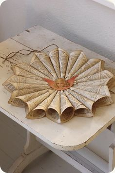 Old Fashioned Christmas Decorations - vintage paper shaped into cones and attached together to make paper ornaments - via Lilla Blanka