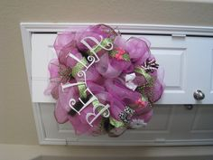This become an heirloom wreath once bows are out you could glue baby shoes, pin toys, photo's etc.