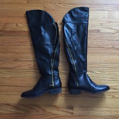 Black report boots. These boots can be a thigh high or you can fold the top down to be. Knee high boot. Very comfortable and has a zipper for easy wearing. Has some minor scuffing on the inside heel and toe that I'm sure can be easily buffed out. Report Shoes