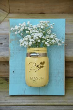 Yellow and coastal blue hanging wall organizer // distressed mason jar decor // reclaimed wood hanger