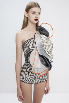Israeli fashion designer Noa Raviv has integrated 3D-printedelements into ruffled garments influenced by distorted digital drawings