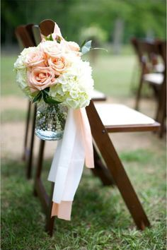 peach rose aisle decor tied with long pink and white ribbons