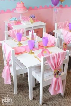 Child sized tables and chairs decorated in a pink princess theme for a 1st birthday party.  See more first girl birthday and party ideas at www.one-stop-party-ideas.com