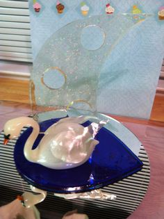 blown sugar swan - This was a quickly centerpiece.  I should have added more but ran out of time.  The clear piece behind had hologram dust in it.  This made it pop and the mirror below gave the illusion of reflection in the water.