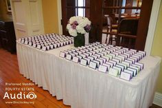 A bride and groom set out their table cards at the Evanston Golf Club. http://www.discjockey.org