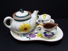 "Rare Tea Set with Tray, Teapot, Creamer and Sugar Bowl by Stangl. The pattern for the teapot is Garden Flower. The pattern for the tray, creamer and sugar is Fruit. The teapot measures 6"" in height with lid and 9 1/2"" from handle to spout. 
