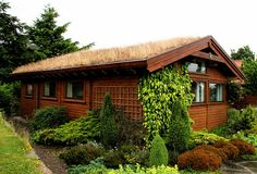 house with sod roof at the findhorn foundation community in scotland.