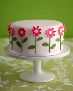 Oh my gosh!!  I LOVE this cake!  It is simple and elegant.  I just had to show you.  Might just do something like this for my birthday!       'Pink Daisy' birthday cake    : Madagascar vanilla bean cake, vanilla bean  buttercream, raspberry preserve, Satab ribbon, handmade sugar flowers