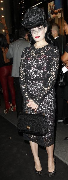 Who made Dita Von Teese's black lace pumps, black long sleeve dress, and black pumps that she wore to the Naomi Campbell 25 years with Dolce & Gabbana event?