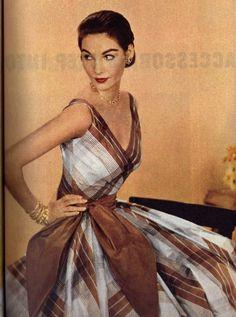 1950's Glamour. party dress brown tan white plaid low cut photo print ad model 50s fashion