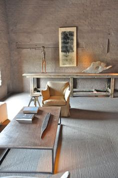 Wow type table, long library table, and sculptural accessories enhanced by art work & quality of light.