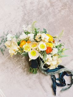 Yellow and orange wedding bouquet. @weddingchicks
