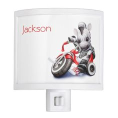 "This adorable kid's night light features a baby ""biker"" zebra riding a red tricycle and has a red name customization option in the upper left corner."