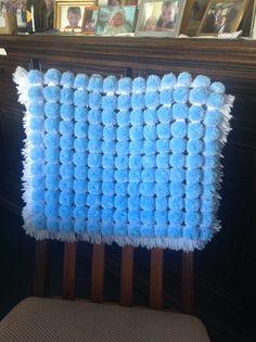 First loom board pom pom blanket I made