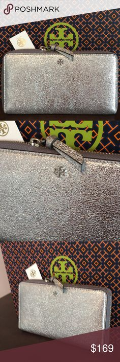 🆕TORY BURCH LARGE NEW WALLET 💯AUTHENTIC 🆕TORY BURCH LARGE NEW WITH TAG NEVER USED ZIP WALLET 💯AUTHENTIC ! STUNNING AND STYLISH TOTALLY ON TREND! JUST LOVELY! TRUE HIGH END LUXURY AND STYLE! IT HAS A GREAT 3 SIDE ZIPPER . INSIDE HR LARGE WALLET IS A ZIP SECTION, 8 CARD SLOTS, TWO LARGE WALL POCKETS AND 2 OPEN SECTIONS FOR MORE ITEMS. WHAT AN AMAZING WALLET! COMES WITH TORY BURCH GIFT BAG. NEW BUT NO PRICE ON TAG. THE PERFECT LARGE WALLET FOR ANY WOMAN! Tory Burch Bags Wallets