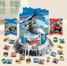 """LEGO City Centerpiece Party Accessory by AMSCAN *. $9.49. Includes one package of 1.. LEGO City Centerpiece is made of cardboard and measures 15.5"""" high x 12.6"""" wide. . *This is an officially licensed LEGO product."""