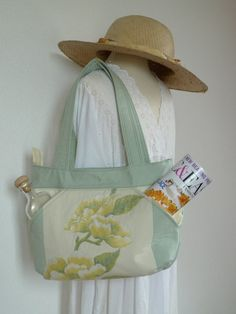 Unique, one of a kind, handmade, fabric shoulder bag.Measurements are approximately: 32 cm wide, 22 cm high and 10 cm deep. Great for every day use and easy to take with your on holidays.
