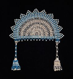 Headdress Date: ca. 1860 Culture: American Medium: Shell, beads Credit Line: Brooklyn Museum Costume Collection at The Metropolitan Museum of Art, Gift of the Brooklyn Museum, 2009; Gift of J. Townsend Russell, 1959 Accession Number: 2009.300.5064