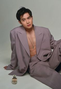 """""""Kim Junmyeon in colored suits with no shirt undearneath is one of my favorite concepts ever"""""""