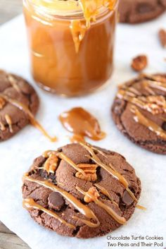 Chocolate Turtle Cookies with a drizzle of salted caramel sauce! Recipe on www.twopeasandtheirpod.com