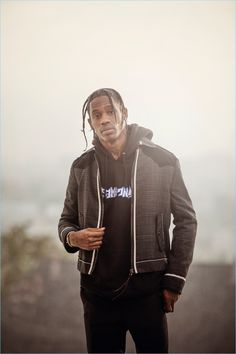 Front and center, Travis Scott sports a Lanvin jacket and trousers with a F**king Awesome sweatshirt.