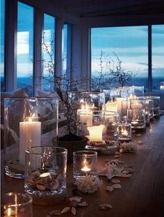 Coastal living tablescape with a view to die for. Love the candles, hurricane and shell combination: simple, but beautiful. Light it up with Mirage LED candles so you can use the remote. Coastal Homes, Coastal Living, Coastal Style, Coastal Decor, Coastal Colors, Bright Colors, Wedding Decorations, Table Decorations, Beach House Decor