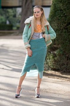 Acne. Hanne Gaby Odiele in mint coloured jacket, orange and grey top, mint coloured, knee length boucle skirt, wedged heels. Paris Fashion Week, Street style.