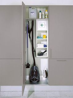 Cleaning closet storage cupboard for vacuum. The rest of the tall cupboards have large open space with a top shelf Cleaning Cupboard, Laundry Cupboard, Cleaning Closet, Cupboard Storage, Kitchen Storage, Kitchen Cupboard, Utility Room Storage, Utility Closet, Laundry Room Organization