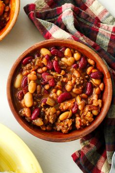 Crock Pot Cowboy Beans are a hearty and filling side dish made with a pound a beef, a pound of bacon, and three kinds of beans, all slow-simmered in a sweet and tangy brown sugar molasses sauce. Slow Cooked Meals, Slow Cooker Recipes, Crockpot Recipes, Cooking Recipes, Hobo Beans Recipe, Baked Bean Recipes, Bacon Recipes, Cowboy Beans, Cassoulet