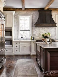 I like the beams, range hood & mix of wood and cream cabinetry.