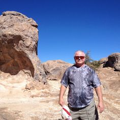 Bill with some of the rocks in behind