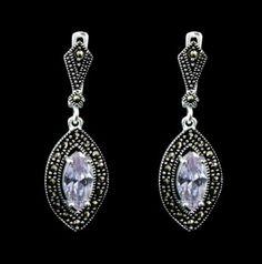 Brinco com zircônia lilás repleto de marcassitas! Um luxo que você merece! :) https://www.pratafina.com.br/prod/brinco-balanco-zirconia-lilas-c-marcassita-23488