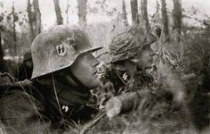 The SS soldiers Crouching await the next Soviet assault