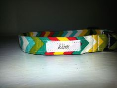 Yellow, red, teal, white chevron pattern with a black buckle.  Can be customized with a matching red or yellow buckle!   ----------------How it's made---------------- - 100% cotton fabric collar with medium weight interfacing - Beautiful designer cotton fabric - Fabric treated for stain prev...