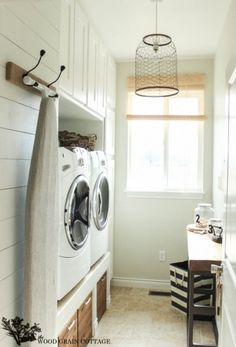 Love the plank wall in this laundry room and the chicken wire chandelier from The Wood Grain Cottage! eclecticallyvintage.com