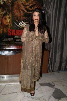 Aishwarya Rai Bachchan looks absolutely amazing in a dull gold Sabyasachi suit