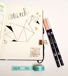 Bullet journal monthly cover page, paper swan drawing, March cover page, hand lettering. | @she_reads_a_book