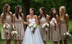 Tan or taupe bridesmaids dresses look lovely with the bouquets, and they don't overpower the wedding gown.