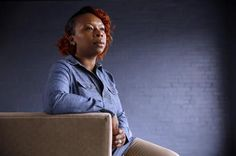 """In this April 27, 2016, photo, Lezley McSpadden poses for a portrait in St. Louis. McSpadden was sitting in her car on a smoke break from her grocery store job on Aug. 9, 2014, when a friend told her someone had been shot near Canfield Apartments in Ferguson, Mo. After that her life crumbled learning her son, 18-year-old son Michael Brown, had been shot and killed by a police officer. McSpadden recounts what happened that fateful day two summers ago in her autobiography, """"Tell the Truth…"""