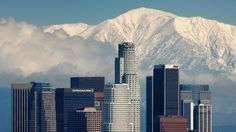 I miss this view!  Fresh snow blankets the mountains behind the downtown skyline after a series of storms that hammered northern California delivered much needed precipitation to the Greater Los Angeles Area January 7, 2008 in Los Angeles, California. (Photo by David McNew/Getty Images)