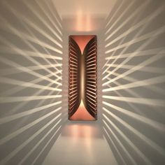 Fantastically geometric construction with magical sharp shadows. Copper Wall Light, Copper Lighting, Luxury Lighting, Unique Lighting, Lighting Ideas, Wall Lamp Shades, Wall Lamps, Pillar Lights, Geometric Construction