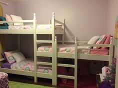 This is our version of the triple bunk.  Built by my son.  I liked the lowest bunk was not on the floor.  We used short table legs as finials to make it a little more feminine.