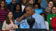 Obama mocks 'demon' talk by sniffing himself