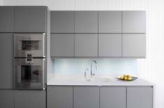 Sola Sletten in grey with white Corian worktop