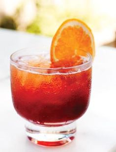 """Negroni Sbagliato means """"messed up"""" or """"mistaken"""" in Italian, and while the Negroni Sbagliato is said to be the result of a busy bartender mistakenly using sparkling wine instead of gin in a Negroni, we think it turned out to be a pretty happy accident. Photo by Stuart Mullenberg. #newgroniweek"""