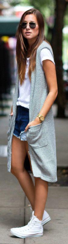 A long cardigan vest with distressed denim shorts and a plain white tee. Via Danielle Bernstein Vest: ASOS, Tee: Mint Style, Shorts: Paige Denim, Shoes: Converse, Sunnies: Prada