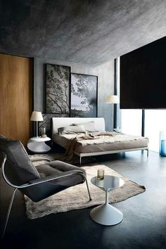 I really like this modernized bedroom. The nightstand has a really cool design to it.